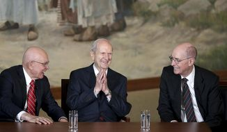 President Russell M. Nelson, center, is announced as the 17th president of the The Church of Jesus Christ of Latter-day Saints, Tuesday, Jan. 16, 2018 in Salt Lake City. At left, President Dallin H. Oaks, first counselor and President Henry B. Eyring, right, second counselor in the First Presidency.  (Spenser Heaps/The Deseret News via AP)