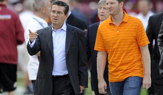 FILE - In this Aug. 29, 2012, file photo, Washington Redskins owner Dan Snyder, left, walks with NASCAR driver Dale Earnhardt Jr., on the field before an NFL preseason football game against the Tampa Bay Buccaneers, in Landover, Md. Earnhardt has never attended a Super Bowl, but is a rabid Redskins fan. Earnhardt will be part of the network's pregame show before the Super Bowl, then head to South Korea for NBC Sports' coverage of next month's Olympics. (AP Photo/Nick Wass, File)