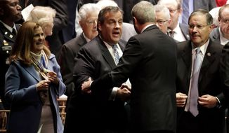 Former New Jersey Gov. Chris Christie, center left, shakes hands with Gov. Phil Murphy, center right, after Murphy gave his address after being sworn in as governor during his inauguration, Tuesday, Jan. 16, 2018, in Trenton, N.J. (AP Photo/Julio Cortez)