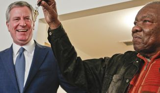 Jasper Hurst, 79, right, show keys he received from Mayor Bill de Blasio, left, after he signed a lease inside his new affordable apartment, Tuesday Jan. 16, 2018, at the Cypress Hills Senior Residences in Brooklyn, New York. (AP Photo/Bebeto Matthews)
