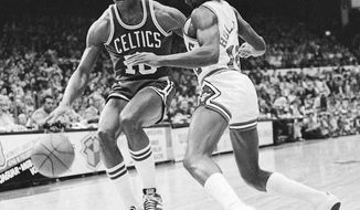FILE - In this Dec. 30, 1977 file photo, Jo Jo White, left, of Boston Celtics, drives past Chicago Bulls' Wilbur Holland (12) during an NBA basketball game in Chicago. Basketball Hall of Famer Jo Jo White, a two-time NBA champion with the Boston Celtics and an Olympic gold medalist, has died. He was 71. The Celtics announced his death Tuesday, Jan. 16, 2018. No cause was provided. (AP Photo/Fred Jewell, File)