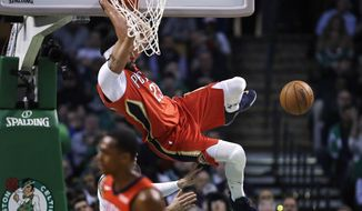 New Orleans Pelicans forward Anthony Davis slams a dunk during the first quarter of an NBA basketball game against the Boston Celtics in Boston, Tuesday, Jan. 16, 2018. (AP Photo/Charles Krupa)