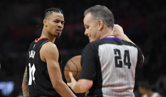 Houston Rockets guard Gerald Green, left, looks at referee Mike Callahan after receiving a technical foul during the second half of an NBA basketball game against the Los Angeles Clippers, Monday, Jan. 15, 2018, in Los Angeles. The Clippers won 113-102. (AP Photo/Mark J. Terrill) **FILE**