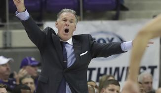 """FILE - In this Dec. 22, 2017, file photo, TCU head coach Jamie Dixon yells from the sideline during the second half of an NCAA college basketball game against William & Mary, in Fort Worth, Texas. Dixon still feels good about this team, even after a three-game losing streak _the last two in overtime on the road. Two weeks after the highest ranking in school history, the Horned Frogs are still in the Top 25. """"We're playing in the toughest league in the country. We've had a tough stretch,"""" Dixon said. (AP Photo/LM Otero, File)"""