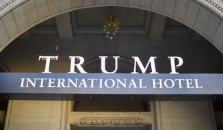 FILE - This Sept. 12, 2016, file photo, shows the exterior of the Trump International Hotel in downtown Washington. More than 60 groups, including foreign governments, political campaigns and business organizations, spent money at Trump-branded properties across the U.S. last year, according to a report Tuesday by a watchdog group that has long been critical of how such spending could be used to influence the president. (AP Photo/Pablo Martinez Monsivais, File)