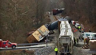 In this Monday, Jan. 15, 2018 photo, emergency crews work the scene of a train derailment in Giles County, Va. No injuries were reported.   (Mike Gangloff /The Roanoke Times via AP)