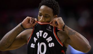 Toronto Raptors guard DeMar DeRozan reacts during a timeout in the second half of the team's NBA basketball game against the Golden State Warriors on Saturday, Jan. 13, 2018, in Toronto. (Cole Burston/The Canadian Press via AP)