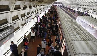 In this Jan. 11, 2018, photo, riders wait to board as others depart a Metro train in the Gallery Place-Chinatown Metro Station in Washington. Washington's Metro system has become internationally synonymous with delays, breakdowns and smoke-filled tunnels. (AP Photo/Alex Brandon)