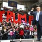 Then presidential candidate Donald Trump at a 2016 campaign rally in Pennsylvania, facing an enthusiastic audience. Grass-roots voters appear to remain in his corner, according to a new survey from Zogby Analytics. NASCAR fans give Mr. Trump a 64 percent approval rating. (Associated Press)