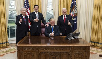 President Donald J. Trump celebrates the passage of the Tax Cuts Act with Vice President Mike Pence, Senate Majority Leader Mitch McConnell, and Speaker of the House Paul Ryan | December 20, 2017 (Official White House Photo by Joyce N. Boghosian)