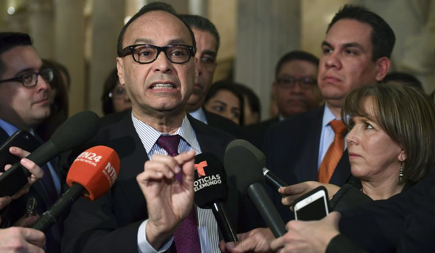 Rep. Luis Gutierrez, D-Ill., center, standing with Rep. Michelle Lujan Grisham, D-N.M., right, chairwoman of the Congressional Hispanic Caucus, and Rep. Pete Aguilar, D-Calif., second from right, speaks with reporters on Capitol Hill in Washington, Wednesday, Jan. 17, 2018, following a meeting with the Congressional Hispanic Caucus and White House Chief of Staff John Kelly. (AP Photo/Susan Walsh)