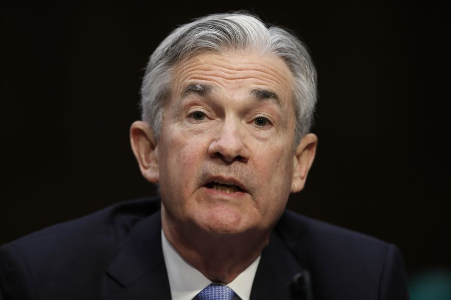 FILE - In this Tuesday, Nov. 28, 2017, file photo, Jerome Powell, President Donald Trump's nominee for chairman of the Federal Reserve, testifies during a Senate Banking, Housing, and Urban Affairs Committee confirmation hearing on Capitol Hill in Washington. On Wednesday, Jan. 17, 2018, the Senate Banking Committee voted for a second time to approve Powell to be the next chairman of the Federal Reserve. (AP Photo/Carolyn Kaster, File)