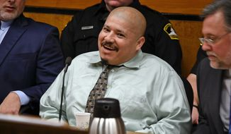 FILE - This Tuesday, Jan. 16, 2018 file photo shows Luis Bracamontes acting out in court during day one of his trial in Sacramento, Calif., Superior Court. Bracamontes, an illegal immigrant from Mexico, and his wife, Janelle Monroy are accused of a daylong crime spree in 2014 that killed Sacramento Sheriff's Deputy Danny Oliver and Placer County Sheriff's Deputy Michael Davis Jr. On Wednesday, Jan. 17, the second day of his trial, Bracamontes was removed from the courtroom after he began shouting profane threats. The judge ordered Bracamontes removed until he promises to behave himself. (Randy Pench/The Sacramento Bee via AP, File)