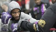 Lamont Peterson defends while while sparring with a trainer during a workout at Gleason's Gym, Wednesday, Jan. 17, 2018, in the Brooklyn borough of New York. Peterson faces Errol Spence Jr. on Saturday in Brooklyn, for Spence's IBF welterweight title. (AP Photo/Mary Altaffer)