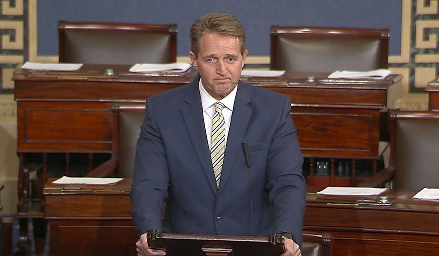 In this image from video from Senate Television, Sen. Jeff Flake, R-Ariz. speaks on the Senate floor, Wednesday, Jan. 17, 2017 at the Capitol in Washington.  IFlake called Trumps repeated attacks on the media shameful and repulsive and said Trump has it precisely backward. Flake said despotism is the enemy of the people, while a free press is the despots enemy and a guardian of democracy. (Senate TV via AP)