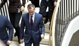 President Donald Trump's former campaign manager Corey Lewandowski, center, arrives on Capitol Hill in Washington, Wednesday, Jan. 17, 2018, where his is expected to be interviewed by the House Intelligence Committee regarding the Russia probe. (AP Photo/Susan Walsh)