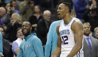 Charlotte Hornets' Dwight Howard (12) reacts to making two free throws against the Washington Wizards during the second half of an NBA basketball game in Charlotte, N.C., Wednesday, Jan. 17, 2018. (AP Photo/Chuck Burton)