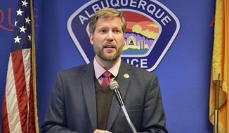 Albuquerque Mayor Tim Keller, left, discusses the city's backlog of untested evidence kits from sexual assault investigations at a news conference in Albuquerque, N.M., on Wednesday, Jan. 17, 2018. Keller, who took office last month, has signed an executive order requiring police to develop a plan by mid-March to clear the city's backlog of several thousand rape evidence kits. (AP Photo/Mary Hudetz).