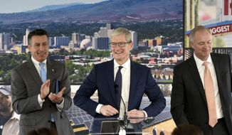 Apple CEO Tim Cook is introduced during ceremony celebrating a new Apple warehouse on Wednesday, Jan. 17, 2018, in Reno, Nev. (Andy Barron/The Reno Gazette-Journal via AP)