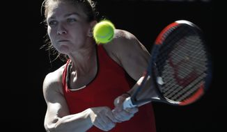 Romania's Simona Halep makes a backhand return to Australia's Destanee Aiava during their first round match at the Australian Open tennis championships in Melbourne, Australia, Tuesday, Jan. 16, 2018. (AP Photo/Vincent Thian)
