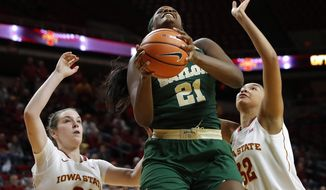 Baylor center Kalani Brown, center, drives to the basket between Iowa State's Bridget Carleton, left, and Meredith Burkhall, right, during the first half of an NCAA college basketball game, Wednesday, Jan. 17, 2018, in Ames, Iowa. (AP Photo/Charlie Neibergall)
