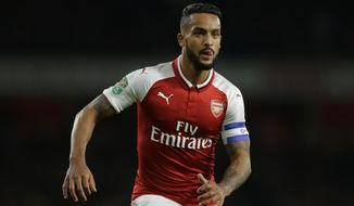 FILE - In this Tuesday, Oct. 24, 2017 file photo, Arsenal's Theo Walcott watches for the ball during their English League Cup soccer match between Arsenal and Norwich at the Emirates Stadium in London. Theo Walcott has joined Everton in a bid to reignite his career after 12 years at Premier League rival Arsenal. Everton announced the signing of the 28-year-old winger on Wednesday, Jan. 17, 2018. (AP Photo/Alastair Grant, file)