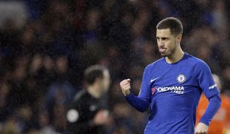 Chelsea's Eden Hazard celebrates during the English FA Cup third round replay between Chelsea and Norwich City at the Stamford Bridge, in London, Wednesday, Jan. 17, 2018. (AP Photo/Alastair Grant)