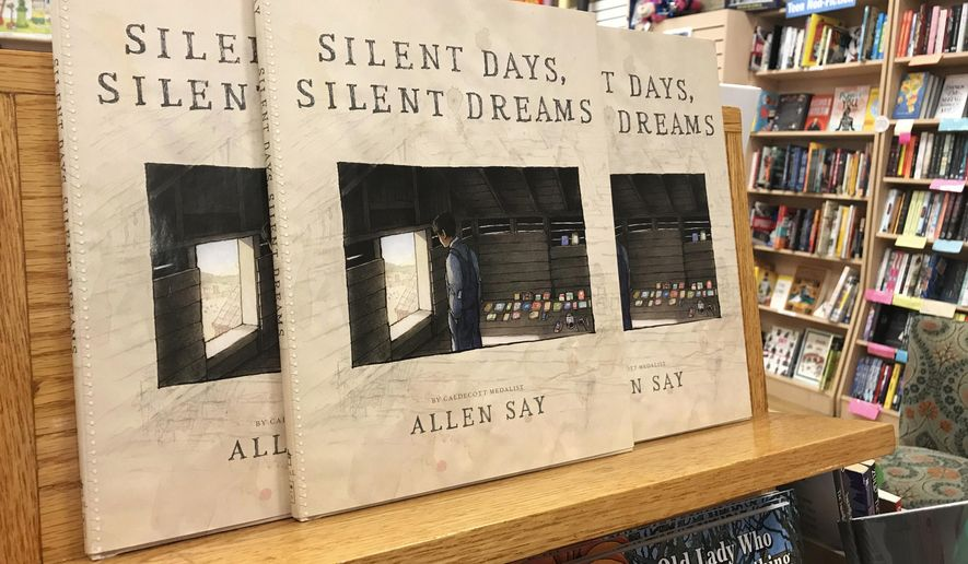 """FILE - In this Oct. 31, 2017, file photo, copies of Allen Say's """"Silent Days, Silent Dreams"""" sit on a bookshelf at a store in Boise, Idaho. The Boise, Idaho,-based James Castle Collection and Archive in a document filed Tuesday, Jan. 16, 2018, in U.S. District Court says Allen Say's """"Silent Days, Silent Dreams"""" steals images created by Castle and its lawsuit should be allowed to proceed. (AP Photo/Keith Ridler, File)"""