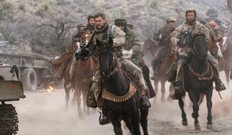 "Screenwriters of ""12 Strong"" took pains to show the Horse Soldiers working together as a unit with a single goal, said former Green Beret Mark Nutsch. (Associated Press/File)"