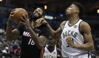 Miami Heat's James Johnson drives past Milwaukee Bucks' Giannis Antetokounmpo during the first half of an NBA basketball game Wednesday, Jan. 17, 2018, in Milwaukee. (AP Photo/Morry Gash)