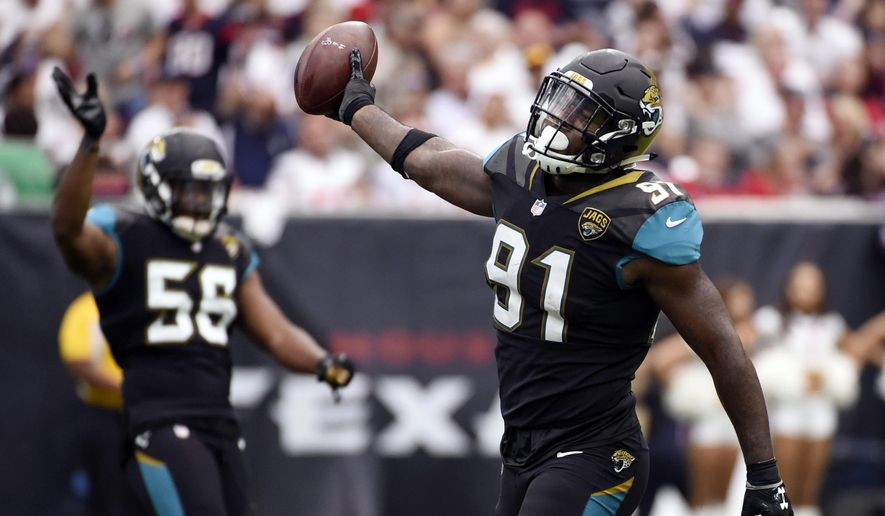 FILE- In this Sept. 10, 2017, file photo, Jacksonville Jaguars defensive end Yannick Ngakoue (91) celebrates after he recovered a fumble by Houston Texans quarterback Deshaun Watson during the second half of an NFL football game in Houston. The second-year pro led the NFL with six forced fumbles in the regular season and added another one last week at Pittsburgh. Ngakoue would love to add New England's Tom Brady to his growing resume in the AFC championship game. (AP Photo/Eric Christian Smith, File) **FILE**