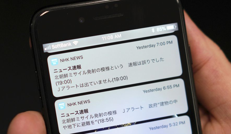 "A smartphone shows Tuesday's NHK television's news website saying ""North Korea appears to have fired a missile,"" ""The government: Seek shelter inside buildings and basements,"" second from top, in Tokyo Wednesday, Jan. 17, 2018. The Japan's public broadcaster mistakenly sent an alert on Tuesday warning citizens of a North Korean missile launch and urging them to seek immediate shelter, then minutes later corrected it, top, days after a similar error in Hawaii. The message at top reads: ""The flash of North Korea's missile launch was a mistake."" (AP Photo/Eugene Hoshiko)"
