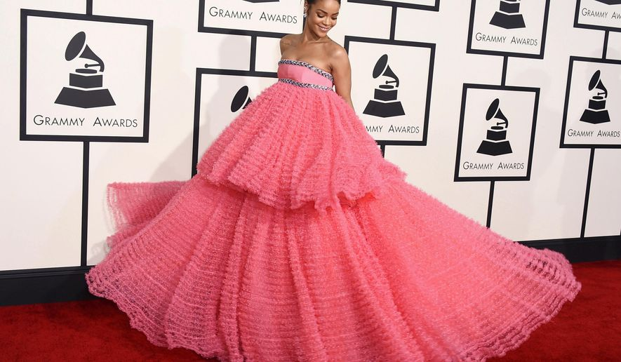In this Feb. 8, 2015 file photo, Rihanna arrives at the 57th annual Grammy Awards in a two-tiered pink Giambattista Valli dress in Los Angeles. (Photo by Jordan Strauss/Invision/AP)