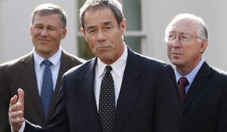 FILE - In this Nov. 2, 2009 file photo, former Alaska Gov. Tony Knowles, center, accompanied by Rep. Jay Inslee, D-Wash., left, and Interior Secretary Ken Salazar, gestures while speaking to members of the media following their meeting at the White House in Washington. A U.S. Interior Department official has reacted harshly to the resignation of most members of a board that advises it on national parks. Knowles chaired the congressionally authorized board until Tuesday, Jan. 16, 2018, the Democrat and eight others on the 12-member board sent a resignation letter, saying their requests to meet as prescribed in law have been disregarded. (AP Photo/Pablo Martinez Monsivais,File)