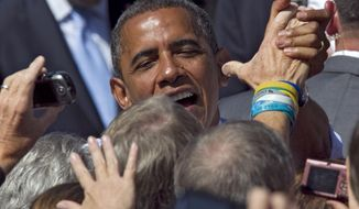 FILE - In this Sept. 13, 2012 file photo taken by Associated Press photographer Ed Andrieski, President Barack Obama greets supporters after speaking at a campaign rally in Golden, Colo. Andrieski, a retired AP photographer who covered nearly every major news story in Colorado for more than three decades, was found dead on Tuesday, Jan. 16, 2018. He was 73. (AP Photo/Ed Andrieski, file)