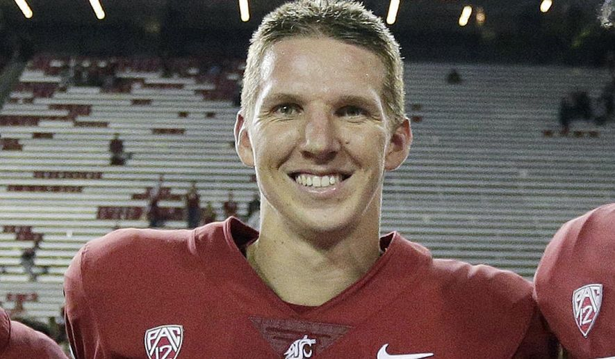 In this Sept. 9, 2017, file photo, Washington State quarterback Tyler Hilinski poses for a photo after an NCAA college football game against Boise State in Pullman, Wash. Hilinski has died from an apparent self-inflicted gunshot wound. An autopsy conducted by the Mayo Clinic found signs of severe brain damage from CTE. (AP Photo/Young Kwak, File) **FILE**