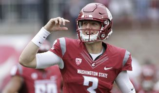 In this Sept. 17, 2016, file photo, Washington State quarterback Tyler Hilinski (3) runs onto the field with his teammates before an NCAA college football game against Idaho in Pullman, Wash. Hilinski has died from an apparent self-inflicted gunshot wound. The 21-year-old Hilinski was discovered in his apartment after he didn't show up for practice Tuesday, Jan. 16, 2018. (AP Photo/Young Kwak, File)