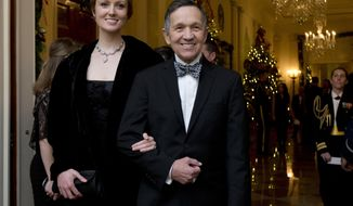 FILE - In this Dec. 8, 2013 file photo, former Rep. Dennis Kucinich, D-Ohio, and his wife Elizabeth Kucinich, arrive for a reception honoring the 2013 Kennedy Center Honors honorees, in the East Room of the White House in Washington. Kucinich is preparing to make the Democratic primary for Ohio governor a five-way race. The outspoken Democrat is set to make his announcement on Wednesday, Jan. 17, 2018, at a community center in Middleburg Heights, Ohio. (AP Photo/Manuel Balce Ceneta, File)