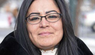 FILE - In this Dec. 8, 2017, file photo, Red Fawn Fallis, of Denver, stands outside the federal courthouse in Bismarck, N.D. Attorneys for Fallis, who is accused of shooting at law officers during protests in North Dakota against the Dakota Access oil pipeline, say they've reached a deal with prosecutors to avoid a lengthy prison term. If a federal judge agrees, Fallis will plead guilty Monday, Jan. 22, 2018, to civil disorder and gun possession by a convicted felon. (Tom Stromme/The Bismarck Tribune via AP, File)