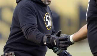 FILE-This file photo from Jan. 14, 2018 shows Pittsburgh Steelers offensive coordinator Todd Haley as he greets players as they come from the field during the second half of an NFL divisional football AFC playoff game against the Jacksonville Jaguars in Pittsburgh. A person with direct knowledge of the decision, confirmed to The Associated Press that the Steelers will not renew Haley's contract. The person spoke on condition of anonymity Wednesday, Jan. 17, 2018, because there was no formal announcement from Haley nor the team. Haley just finished his sixth season with the team. (AP Photo/Keith Srakocic, FILE)
