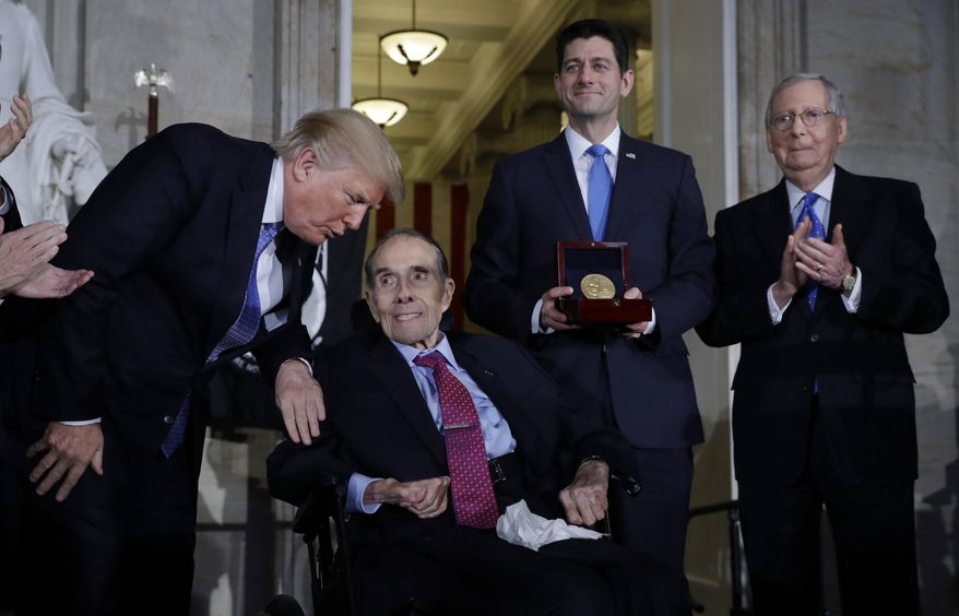 President Donald Trump speaks to former Sen Dob Dole during a Congressional Gold Medal ceremony honoring Dole on Capitol Hill, Wednesday, Jan. 17, 2018, in Washington, as House Speaker Paul Ryan of Wis., and Senate Majority Leader Mitch McConnell, watch. (AP Photo/Evan Vucci)