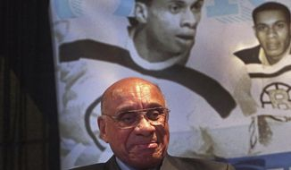 National Hockey League Diversity Ambassador Willie O'Ree, the first black player in the NHL, was honored during a ceremony in Boston on Wednesday, Jan. 17, 2018. The ceremony was attended by Boston Mayor Marty Walsh, NHL commissioner Gary Bettman and Boston Bruins Chief Executive Officer Charlie Jacobs, who joined together at TD Garden to announce that the Boston Parks and Recreation Department's street hockey rink at Smith Field in Allston-Brighton is named in honor of O'Ree. (Barry Chin/The Boston Globe via AP)