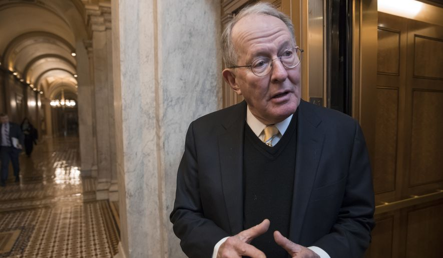 Sen. Lamar Alexander, R-Tenn., chairman of the Senate Health, Education, Labor, and Pensions Committee, pauses for a reporter's question at the Capitol in Washington on Jan. 18, 2018. (Associated Press) **FILE**