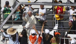 Pope Francis arrives on his pope-mobile to celebrate Mass on Lobito Beach in Iquique, Chile, Thursday, Jan. 18, 2018. (AP Photo/Juan Karita)