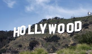 In this Jan. 29, 2010, file photo, the Hollywood sign sits near the top of Beachwood Canyon adjacent to Griffith Park in the Hollywood Hills of Los Angeles. (Associated Press) ** FILE **