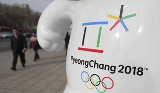 The official emblem of the 2018 Pyeongchang Olympic Winter Games is seen in downtown Seoul, South Korea, Thursday, Jan. 18, 2018. When athletes of the rival Koreas walked together behind a single flag for the first time since their 1945 division at the start of the 2000 Sydney Olympics, it was a highly emotional event that came on the wave of reconciliation mood following their leaders' first-ever summit talks. Eighteen years later, now, the Koreas are pushing to produce a similar drama during the upcoming Pyeongchang Olympics. But they haven't generated as much enthusiastic supports as they had both at home and abroad. (AP Photo/Lee Jin-man)