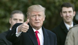 President Donald Trump gives the thumbs-up as he arrives on Marine One at the White House in Washington, Thursday, Jan. 18, 2018, as he returns from Pittsburgh. (AP Photo/Carolyn Kaster)