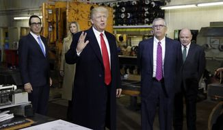President Donald Trump speaks as he takes tour of H&K Equipment Company with owners Peter Cicero and George Koch, right, during a visit to promote his tax and economic plan, Thursday, Jan. 18, 2018, in Coraopolis, Pa. Treasury Secretary Steven Mnuchin and Ivanka listen in the background. (AP Photo/Evan Vucci)