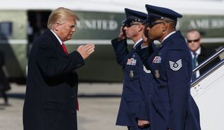 President Donald Trump salutes as he boards Air Force One, Thursday, Jan. 18, 2018, in Andrews Air Force Base, Md. (AP Photo/Evan Vucci)