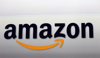 This Sept. 6, 2012, file photo shows the Amazon logo in Santa Monica, Calif. Amazon announced Thursday, Jan. 18, 2018, that it has narrowed down its potential site for a second headquarters in North America to 20 metropolitan areas, mainly on the East Coast. (AP Photo/Reed Saxon, File)